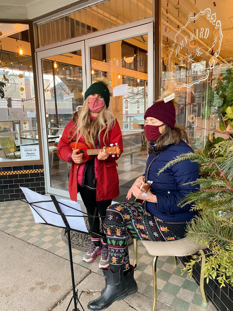 Christine sings holiday carols outside of John Ward Coffee Shop