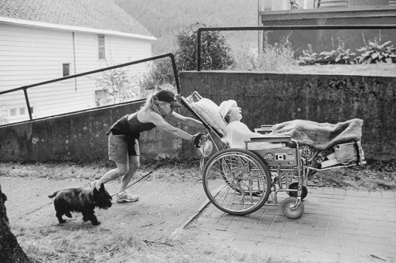 Christine pushing her friend Bridget in a wheelchair